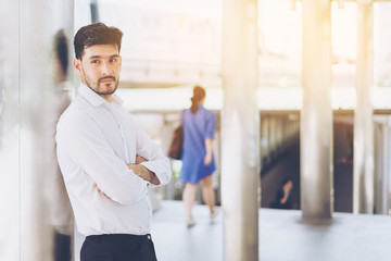 Handsome man wear white shirt while standing. Concept of smart people and business.