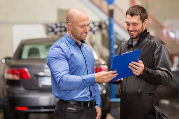 auto mechanic and customer at car shop