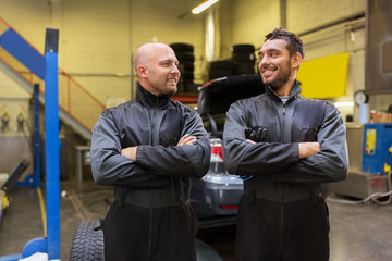 auto mechanics or tire changers at car shop