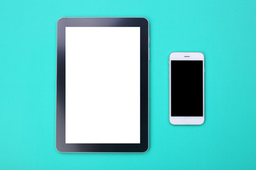 Mockup tablet and smartphone on green pastel background