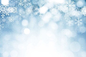 Christmas and New year background. Blue blurred abstract background with snowflake.