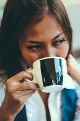 Close-up portrait of beautiful young woman holding cup of tea or coffee, Selective Focus.