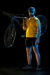 The bicyclist on black, studio shot.