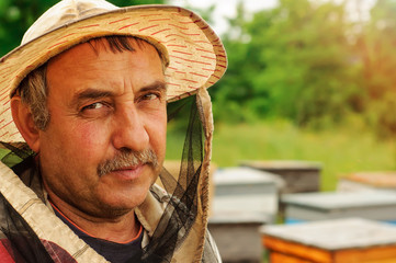 Portrait of a beekeeper on an apiary. Apiary.