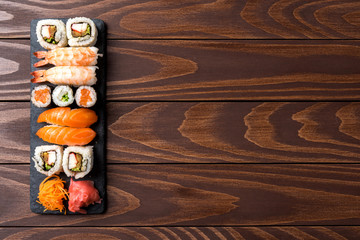 Set of Japanese sushi on wooden background. Close up