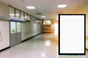 mock up of vertical advertising billboard or blank showcase light box for your text message or media content with blurred image of hospital corridors, commercial, marketing and advertisement concept