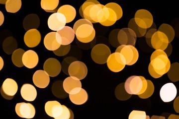 Fotobehang - blurred golden lights over dark background