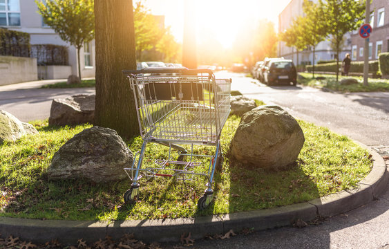 shopping cart abandoned at curbside in residential neighborhood