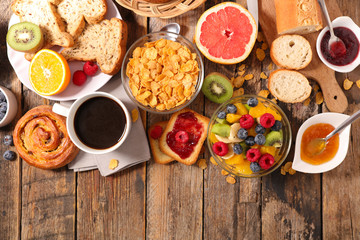 breakfast with coffee, fruit,cereal and croissant