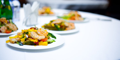 grilled salad with shrimps. plates with salad. delicious. bright salad. restaurant food. a delicacy.