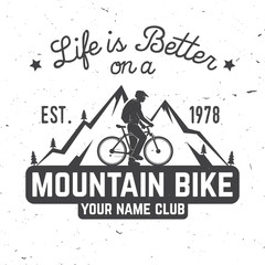Vintage typography design with car and trailer, mountain bikes and mountain silhouette.