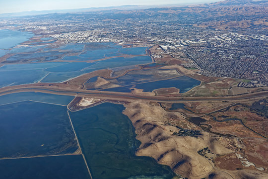 Aerial view of South San Francisco Bay salt flats and foothills.
