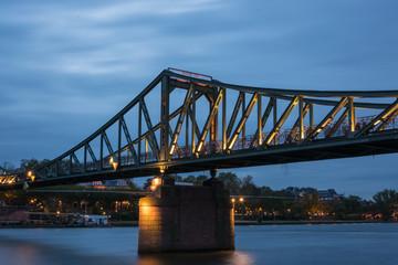 """The bridge """"Eisener Steg"""" over the river Main in Frankfurt during blue hour"""