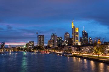The skyline of Frankfurt with the river Main during blue hour