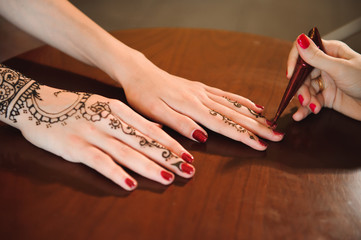 Mehndi is traditional Indian decorative art. Close-up