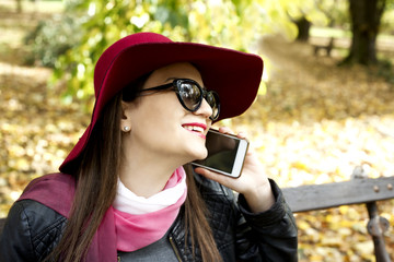 Young fashion business woman calling on mobile phone