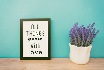 Motivational and inspirational life quotes - all things grow with love. Frame and plant with teal blue background, retro style.