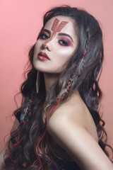 Fashion beauty portrait of a beautiful long-haired brunette in the image of a zodiac Archer.