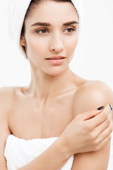 Beauty & Skin care concept - Close up Beautiful Young Woman touching her skin.