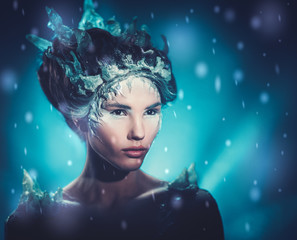 Beautiful ice queen in a falling snow