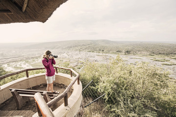 Woman taking picture at overlook in Kruger National Park, South Africa
