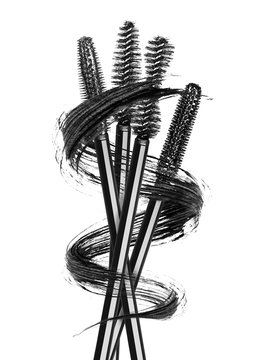 Various mascara brushes wrapped in a smear in the shape of a spiral