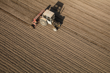 aerial view of the tractor on the harvest field