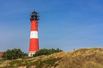 Leuchtturm Hörnum auf Sylt an der Nordsee mit Dünen. ....Lighthouse Hörnum on Sylt at the North Sea, Schleswig-Holstein, Germany with dunes.