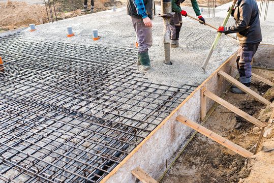 pouring concrete slab - foundation of new house