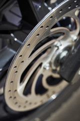 spokes and brake components on custom bike; macro closeup shot of rear motorcycle wheel