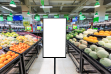 Blank billboard and blurred supermarket fruits background