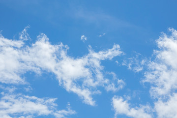Blue sky with clouds. Daylight blue sky background