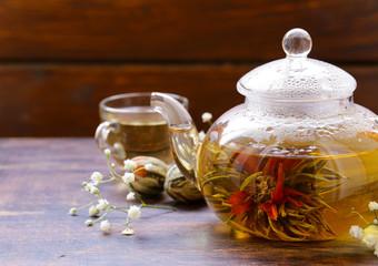 green tea flower (celestial lily) in a glass teapot