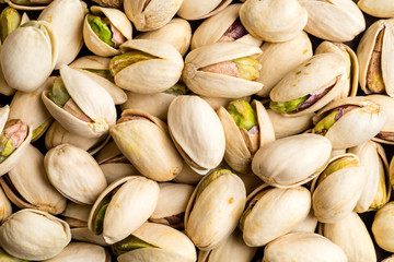 Healthy and delicious roasted salted pistachio nuts background texture from top view