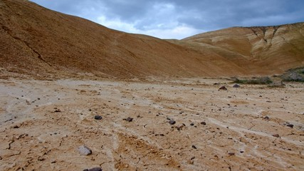 Ominous earth painted hills and stormy sky Spring Sutton Mountain John Day Great Basin High Desert Columbia Plateau