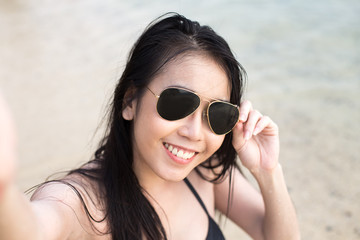Portrait of Happy traveler Woman Selfie with at beach. Asian women using Smartphone with Happy emotions, Woman with Travel Concept.
