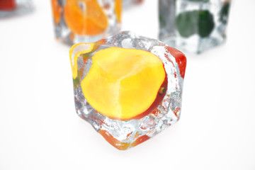 Mango in ice cube isolated on white with depth of field effects. Ice cubes with fresh berries. Berries fruits frozen in ice cubes, 3D rendering