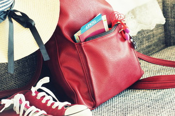 Women s summer outfit: red sneakers, backpack, hat . Traveling background and tourist stuffs. Top view