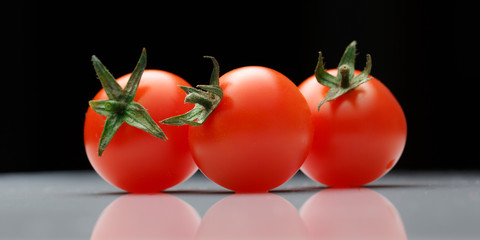 Ripe tomatoes with green twig