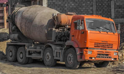 Concrete mixer at the construction site. Construction truck. Construction engineering.