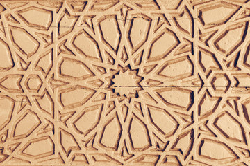 Relief ornament on the brown stone, background, texture