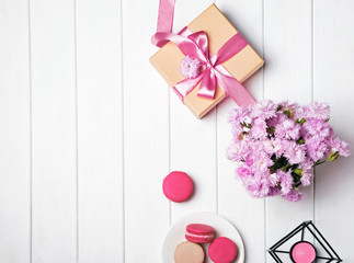 Pink flowers and giftbox with pink ribbon