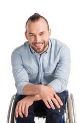 smiling man in wheelchair