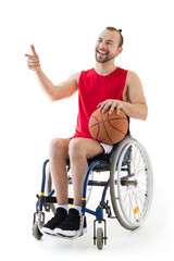 Disabled sportsman holding basketball ball