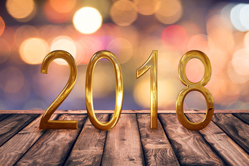 2018, golden numbers on wood table with blurred lights gold bokeh abstract background