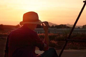 Photographer Women on the prairie at sunset.