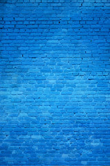 The texture of the brick wall of many rows of bricks painted in blue color