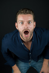 Man with open mouth on bearded face leaning forward