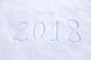 new year date 2018 written in snow background