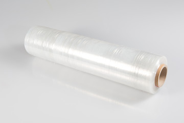 transparent film roll wrapping packaging on white background